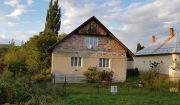 Rodinný dom s veľkým pozemkom v pokojnej lokalite v obci Dolné Motešice