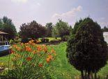 okr. Dunajská Streda - Predáme krásny, priestranný 4 izb. rodinný dom typu bungalov s bazénom, krbom a garážou v obci Blahová