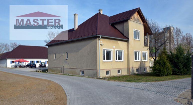Na prenájom polyfunkčná budova s pozemkom /parkovaním