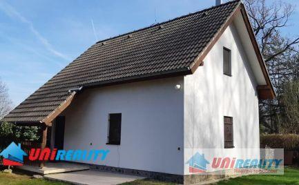 Okres TOPOĽČANY - DUCHONKA – pekná štýlovo zariadená chata s garážou a terasou