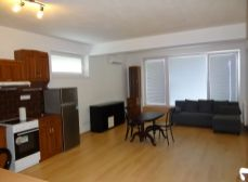 SENEC – NA PRENÁJOM - priestranný 1-izbový byt v novostavbe v centre mesta s terasou . SENEC