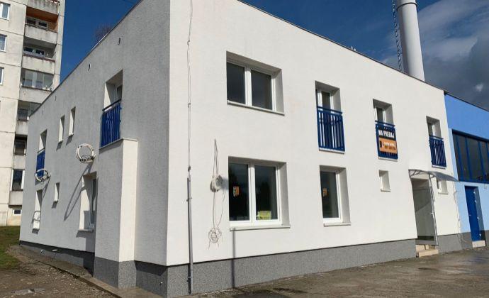 Skolaudovaný bytový dom