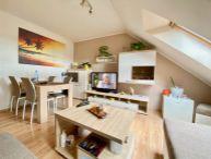 REALFINANC - Priestranný 2.5 izbový byt s balkónom, kompletná rekonštrukcia, 3x rolldor, Brestovany