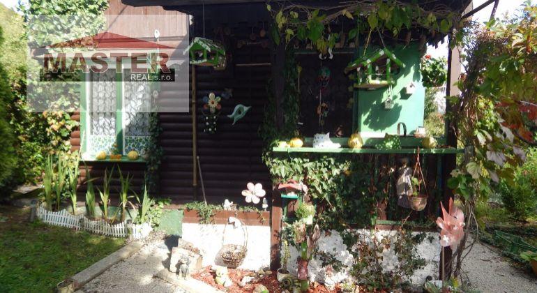 Na  Predaj  drevená chatka so záhradou pozemok 473 m2, Handlová, osada Mlynárka