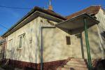 Rodinný dom s 11 jednoizbovými bytmi určených na prenájom.